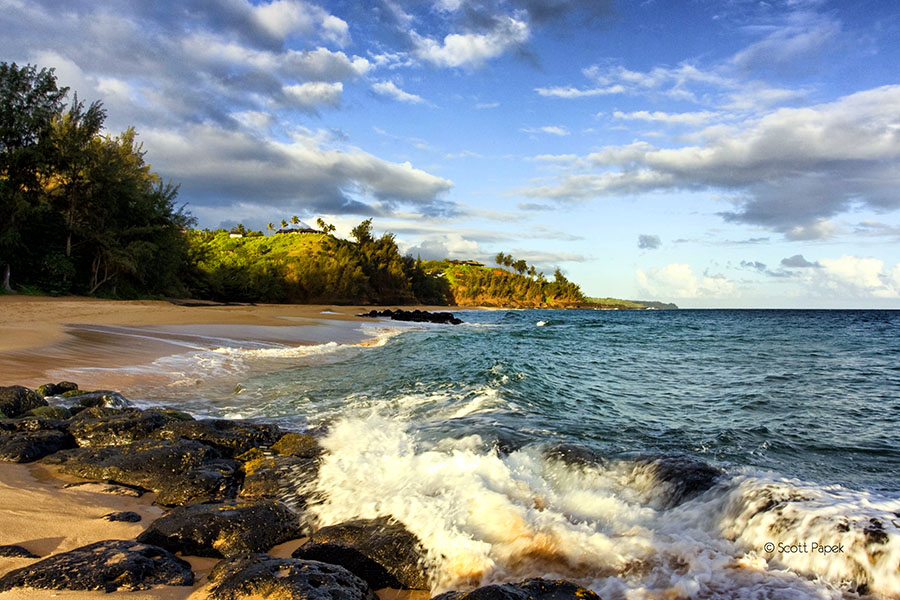A mid morning photograph of Secret Beach beach on the kauai Island in Hawaii.