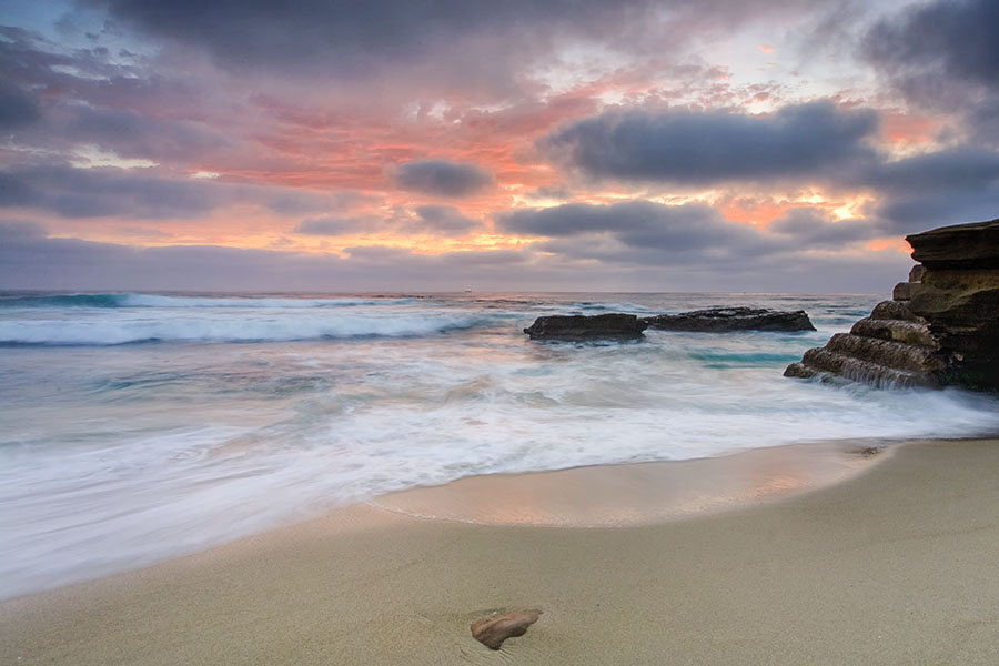 Scott captures the beauty of sunset at the beach in La-Jolla, California between storms on a summer evening.Beach and Ocean photography...